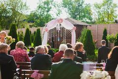 Beautiful wedding ceremony on sunny day. Guests Stock Photo
