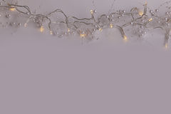 Beautiful wedding or christmas fairly lights with pearls. Beautiful wedding fairly lights with pearls at the top of the picture on a dark background Stock Photography