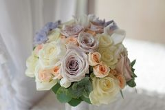 Closeup bouquet of flowers rose and delphinium wedding. Beautiful wedding colorful bouqet bride.Beauty of colored flovers. close up bunch of florests.bridal Royalty Free Stock Photos