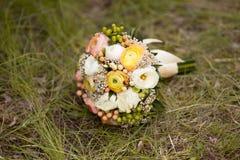 Beautiful wedding colorful bunch of ranunculus. Beautiful wedding colorful bunch of white and yellow ranunculus Royalty Free Stock Image
