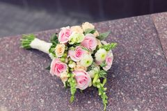 Beautiful wedding colorful nosegay on the stone Royalty Free Stock Photos