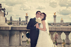 Beautiful wedding couple. Bride and groom on the Alexandre III bridge in Paris. royalty free stock photo