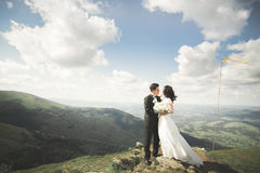 Beautiful wedding couple, bride and groom, in love on the background of mountains Stock Photo