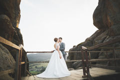 Beautiful wedding couple, bride and groom, in love on the background of mountains Royalty Free Stock Image