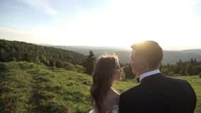 Portrait of young stylish fashion couple posing in summer sunset. stock video footage