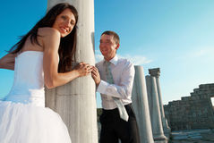 Beautiful wedding couple. Bride and groom near greece column in the ancient city Stock Photos