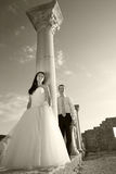 Beautiful wedding couple. Bride and groom near greece column in the ancient city. Black and white, sepia Royalty Free Stock Images