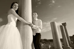 Beautiful wedding couple. Bride and groom near greece column in the ancient city. Black and white, sepia Stock Photo