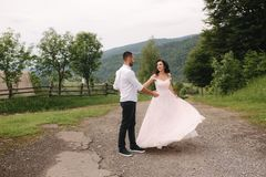 Beautiful wedding couple in Carpathian mountains. Handsome man with attractive woman.  stock images