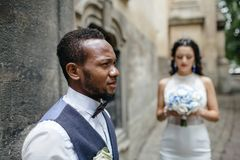 Couple celebrating their wedding day. Beautiful wedding couple celebrating their wedding day ,happy african american groom and caucasian bride Royalty Free Stock Photos