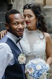 Couple celebrating their wedding day. Beautiful wedding couple celebrating their wedding day ,happy african american groom and caucasian bride Royalty Free Stock Photography