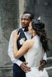 Couple celebrating their wedding day. Beautiful wedding couple celebrating their wedding day ,happy african american groom and caucasian bride Royalty Free Stock Image