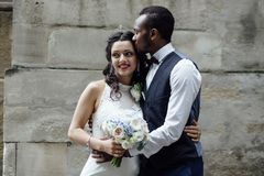 Couple celebrating their wedding day. Beautiful wedding couple celebrating their wedding day ,happy african american groom and caucasian bride Royalty Free Stock Photo