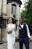 Couple celebrating their wedding day. Beautiful wedding couple celebrating their wedding day ,happy african american groom and caucasian bride Stock Photos