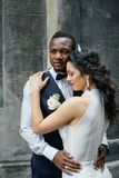 Couple celebrating their wedding day. Beautiful wedding couple celebrating their wedding day ,happy african american groom and caucasian bride Stock Images