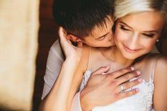 Beautiful wedding couple in doorway Stock Photos