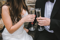 Beautiful wedding couple drinking champagne Stock Image