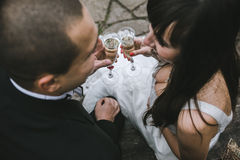 Beautiful wedding couple drinking champagne Royalty Free Stock Photos