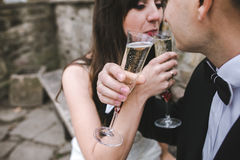 Beautiful wedding couple drinking champagne Royalty Free Stock Photo