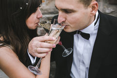 Beautiful wedding couple drinking champagne Stock Photography
