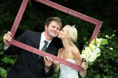 Beautiful Wedding Couple with Frame Stock Photo