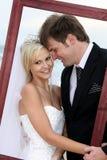 Beautiful Wedding Couple with Frame Royalty Free Stock Photos