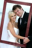 Beautiful Wedding Couple with Frame Stock Photography