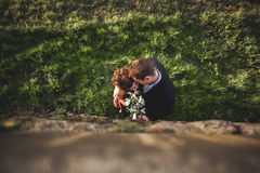 Beautiful wedding couple, girl, man kissing and photographed from above Royalty Free Stock Photography