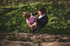 Beautiful wedding couple, girl, man kissing and photographed from above Stock Photos