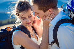 Beautiful wedding couple hugs closeup. Honeymoon in Alps Stock Photos