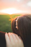 Beautiful wedding couple, love on the sunset. Fielf with flowers Royalty Free Stock Images