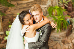 Beautiful wedding couple in park. kiss and hug Stock Photo