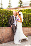 Beautiful wedding couple in park. kiss and hug Stock Photography