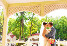 Beautiful wedding couple in park. kiss and hug Stock Images