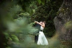 Beautiful wedding couple posing Royalty Free Stock Photography