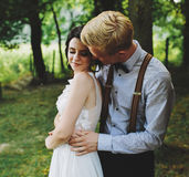 Beautiful wedding couple posing. In a forest Royalty Free Stock Photo