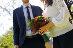 Beautiful wedding couple posing in park stock photography