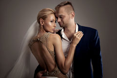 Beautiful wedding couple posing in studio. Stock Photos