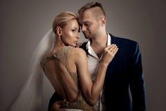 Beautiful wedding couple posing in studio. Stock Photos