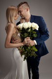 Beautiful wedding couple posing in studio. Royalty Free Stock Images
