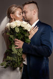 Beautiful wedding couple posing in studio. Stock Image