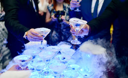 Beautiful wedding couple is pouring champagne indoors Royalty Free Stock Photo