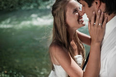 Beautiful wedding couple smiling on the river Royalty Free Stock Photos