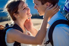 Beautiful wedding couple smiling to each other on sunny day in Alps close up Stock Photos