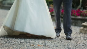 Beautiful wedding couple walks and holds hands close up. Como, Italy stock video footage