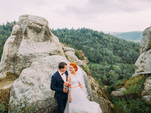 Beautiful wedding couple on wonderful rocky landscape of Carpathians mountains background. Stock Image