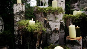 Beautiful wedding decor with candles, birch logs stock video footage