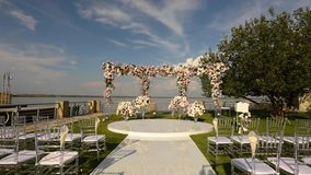 Beautiful wedding decor in white color, a beautiful place for a wedding ceremony.  stock video