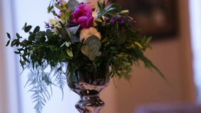 Beautiful wedding decoration made of flowers of different kinds and colors on a wedding table in a fancy restaurant. stock video footage