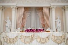 Beautiful wedding decoration set up with flowers. Royalty Free Stock Photo